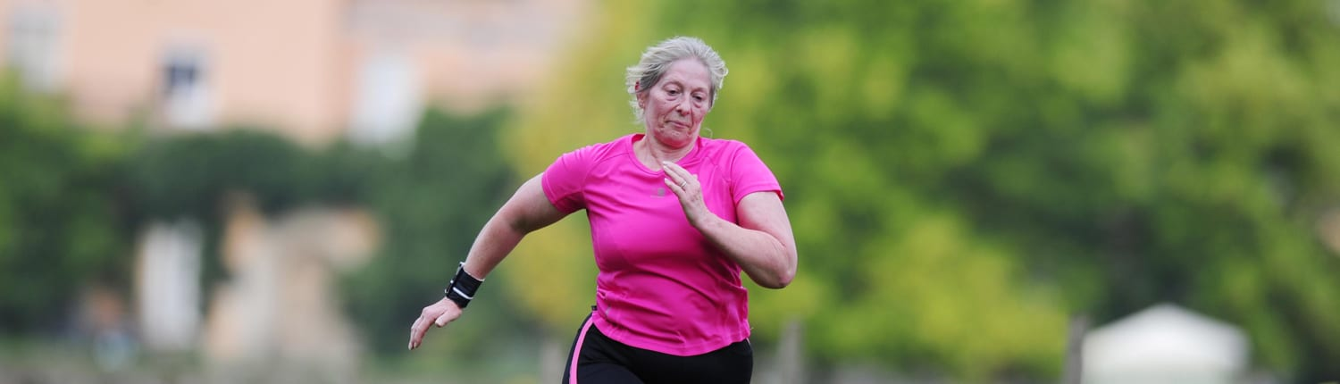 Active Devon Woman Running in Pink