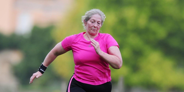 Active Devon Woman Running in Pink