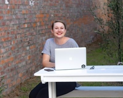 person-sat-outside-with-laptop
